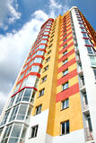 City building. Exterior of modern colored city building. Perspective view Stock Photography