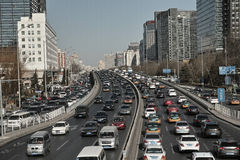 City building and cars. A day busy high way and city stock photography