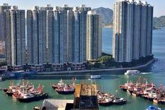 City building and fishing boat, Hongkong 2016. Tall city buildings and fishing boat in harbor of Hongkong, shown as people life and environement in Hongkong, and Stock Images