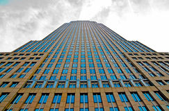 Skyscraper looking up. A breath taking view of a city building looking up as the clouds roll in Stock Photography