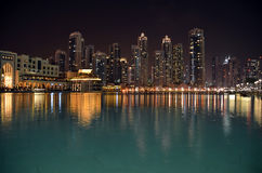 City building at night and water reflect photo Stock Images