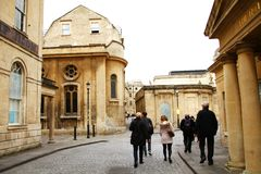 City building scene. BATH, ENGLAND - OCT, 18: Local and domestic tourist atmosphere scene during sightseeing old roman city atmosphere represent cultural and stock photos