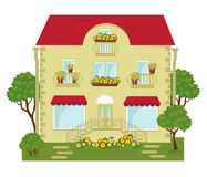City building with a shop on the ground floor. Building with shops on the ground floor and lawn Royalty Free Stock Photos