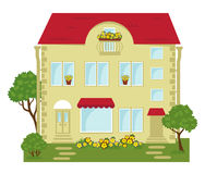 City building with a shop on the ground floor. Building with shops on the ground floor and lawn Stock Image