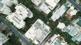 City buildings from above drone aerial stock footage