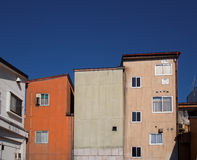 City buildings against deep blue sky Stock Images