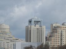 City buildings and cloudy sky stock photo