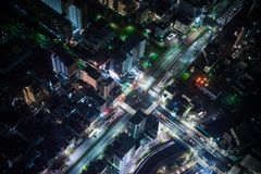 City Buildings and Road in Aerial Photography at Night Stock Photo