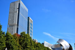 City buildings and roof of Pritzker Pavilion in Chicago. City buildings and roof of Pritzker Pavilion at Millennium Park in Chicago.  Photo taken in October 5th Stock Photo