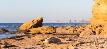 City buildings sea shore view, sunset panorama. Stock Images