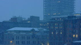 City Buildings In Snowfall In The Evening. Pretty urban scene of city buildings in heavy snowfall stock footage