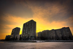 City buildings in sunset. Apartment buildings by the sea in sunset Stock Photo