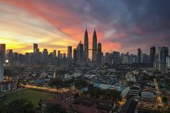 City Buildings Under Orange Sunset Stock Image