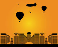 City buildings zeppelin. City  buildings zeppelin birds balloons on yellow background Royalty Free Stock Images
