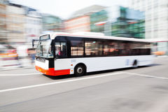 City bus. Driving bus in the city in motion blur Stock Image