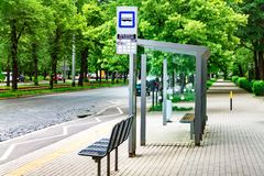City bus stop, empty stop with signs, public transport royalty free stock photo