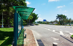 City bus stop. Bus station at road side of city street in China Stock Photography