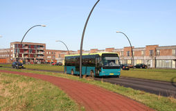 City bus in suburb. City bus driving through a suburb stock photos