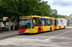 City buses in Hudiksvall. Hudiksvall, Sweden - July 5, 2017:  Tw yellow city buses at the bus stop Centrum in service for Xtrafik Stock Photos