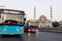 CITY BUSES IN ISTANBUL. Public transportation in front of Yeni Cami, Eminönü, İstanbul, Turkey royalty free stock photos