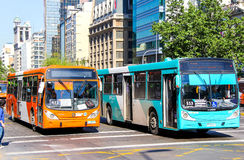 City buses in Santiago, Chile. SANTIAGO, CHILE - NOVEMBER 13, 2015: City buses Marcopolo Gran Viale and Caio in the city street Royalty Free Stock Images