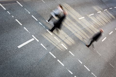City business people crossing a street Royalty Free Stock Images