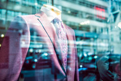 City business people lifestyle concept. Fast city life in window reflection from suit store. Royalty Free Stock Photos