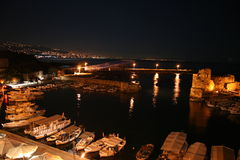 The city of Byblos (Jbeil) by night view over port. The city of Byblos (Jbeil) Lebanon - view over the ancient port with fishing boats and old crusader castle Royalty Free Stock Image