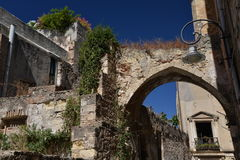 City of Cagliari, Sardinia, Italy. Narrow old street and ruins. View of a Cagliari city centre narrow alley, island of Sardinia, Mediterranean, Italy. Ancient Stock Photos