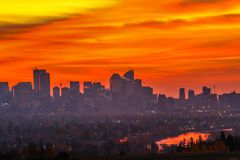 City of Calgary in sunrise silhouette. With reflection along the Bow river Stock Photography