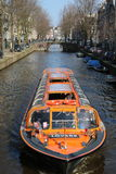 City Canal. Tourist Cruise in Amsterdam City Canal Stock Image