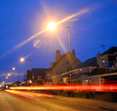 City car and street lights. Photo of city street night lights with car lamps streaking down the road Stock Photo