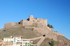 City of Cardona with the Castle. The Castle of Cardona over a dramatic blue sky, Catalonia, Spain Royalty Free Stock Images