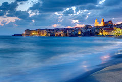 The city of Cefalu and the local beach at dusk Stock Image