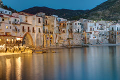The city of Cefalu reaches right to the beach Royalty Free Stock Photos