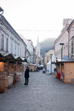 City Celje in Christmas time. Christmas time with Christmas market and fairy land in city Celje in Slovenia. People walking and enjoying the Christmas spirit Stock Photos