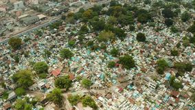 City cemetery in Manila, view from above. Old cemetery with residential buildings. City cemetery in Manila, view from above. Many stone coffins and crypts. Old stock video footage