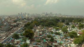 City cemetery in Manila, view from above. Old cemetery with residential buildings. City of Manila, in sunny weather. City cemetery in Manila, view from above stock video