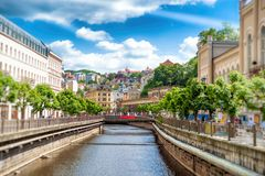 The city center with buildings and hotels along the river Tepla. And bridge over the canal. Karlovy Vary Carlsbad, Czech Republic Stock Images