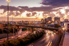 City center with busy motorway during sunset Royalty Free Stock Image