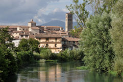 City center and cathedral from velino, rieti. View of city center and cathedral as seen form river bridge on a summer day with  thunderclouds Stock Photos
