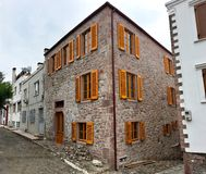 City center houses restoring in a narrow street in Cunda Alibey Island, Ayvalik.  It is a small Stock Photography