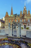 City center of Malmo, Sweden. Old fountain with boy statue and the town hall in Malmo on blue sky background Royalty Free Stock Photography