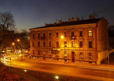City center by night: ancient temements, Krakow, Poland Stock Photo
