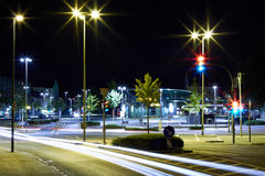 City center at night. On the night propelled at a long exposure light trails produce cars with their headlights stock photo