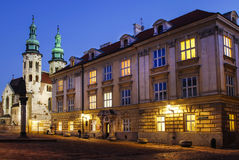 City center by night: saint Andrews church and ancient tenements. Krakow, Poland royalty free stock photography