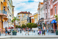 City center street with houses and people in Plovdiv. Plovdiv, Bulgaria - September 3, 2016: City center street with houses and people around Royalty Free Stock Photography
