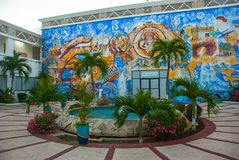 City centre Playa del Carmen. Mosaic on the building and the fountain in the yard. Mexico, Riviera Maya stock photo