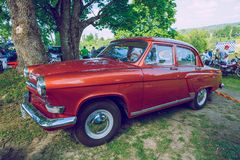 Retro car show, exhibition at city park. Peoples, bikes, cars a royalty free stock images