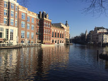 City channel arc. Amsterdam city river channel urban arc house Royalty Free Stock Image